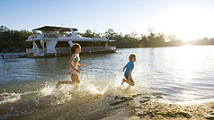 Children playing in the Murray River, Victoria, Australia